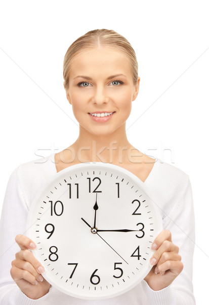 Foto stock: Mulher · grande · relógio · quadro · branco