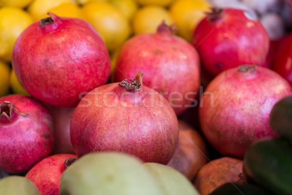 close up of pomegranate at street farmers market Stock photo © dolgachov