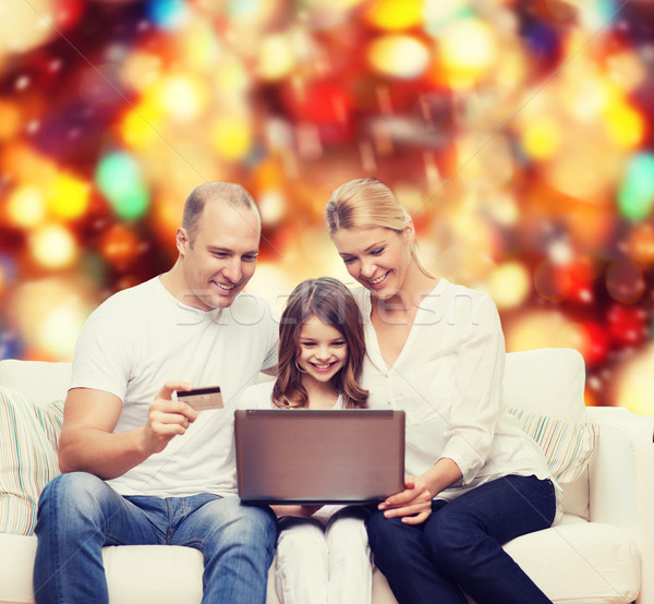 happy family with laptop computer and credit card Stock photo © dolgachov