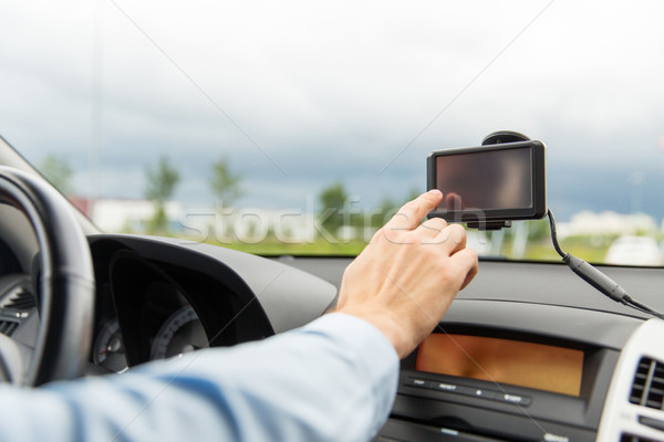 close up of man with gps navigator driving car Stock photo © dolgachov