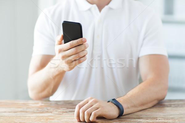 close up of man with smart phone and watch Stock photo © dolgachov