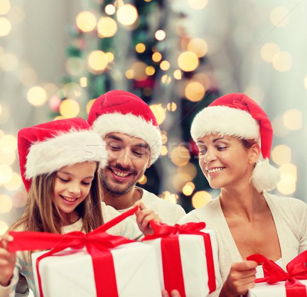 幸せな家族 サンタクロース ヘルパー ギフトボックス 家族 ストックフォト © dolgachov