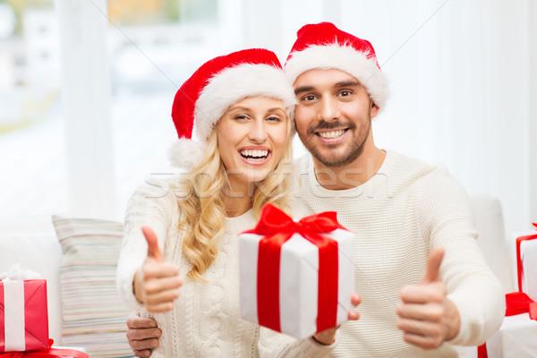 Feliz Pareja Navidad regalos vacaciones Foto stock © dolgachov