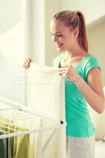 happy woman hanging clothes on dryer at home Stock photo © dolgachov