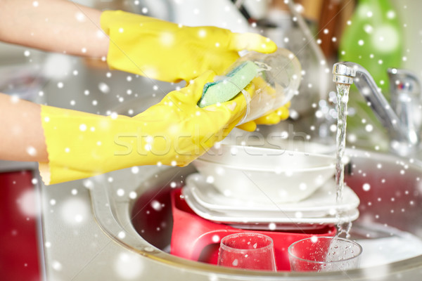 close up of woman hands washing dishes in kitchen Stock photo © dolgachov
