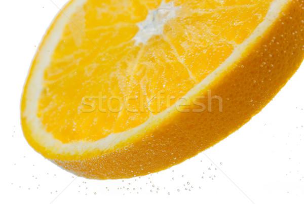 orange slice falling or dipping in water Stock photo © dolgachov
