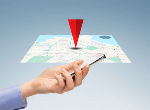 close up of hand with smartphone and navigator map Stock photo © dolgachov