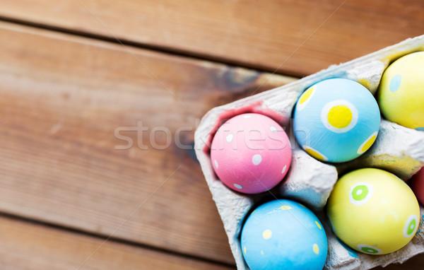 Közelkép színes húsvéti tojások tojás doboz húsvét Stock fotó © dolgachov