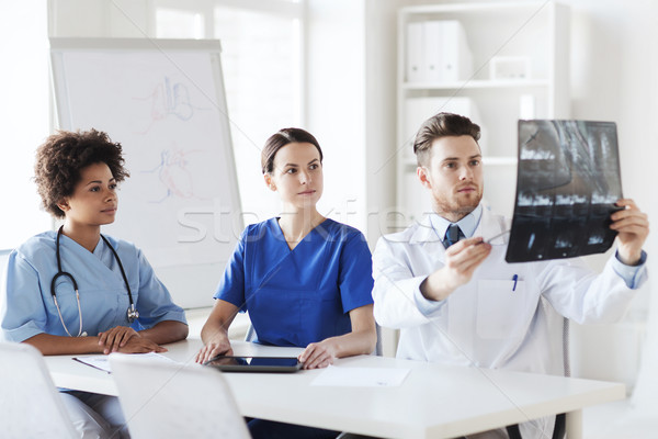 group of doctors discussing x-ray image Stock photo © dolgachov