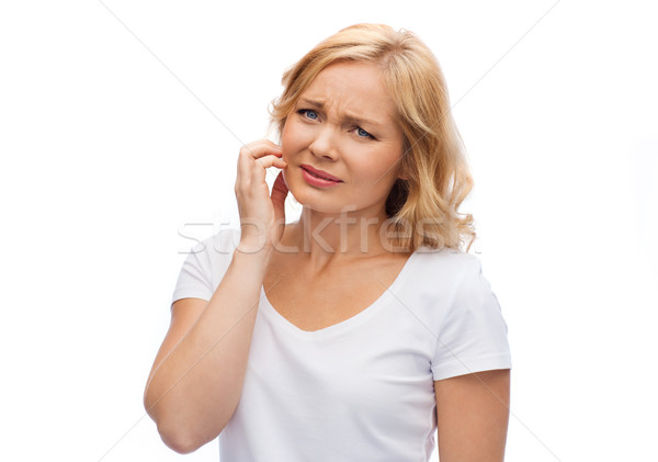 unhappy woman suffering from face inch Stock photo © dolgachov