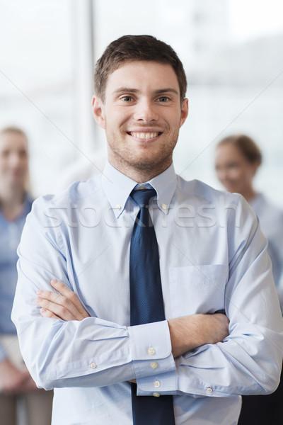 Sorridente empresário colegas escritório pessoas de negócios trabalho em equipe Foto stock © dolgachov