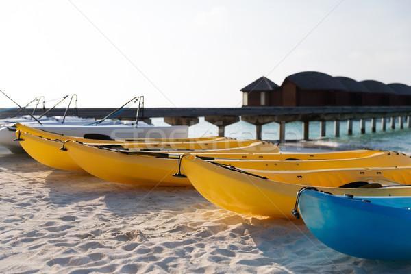 canoes or kayaks mooring on sandy beach Stock photo © dolgachov