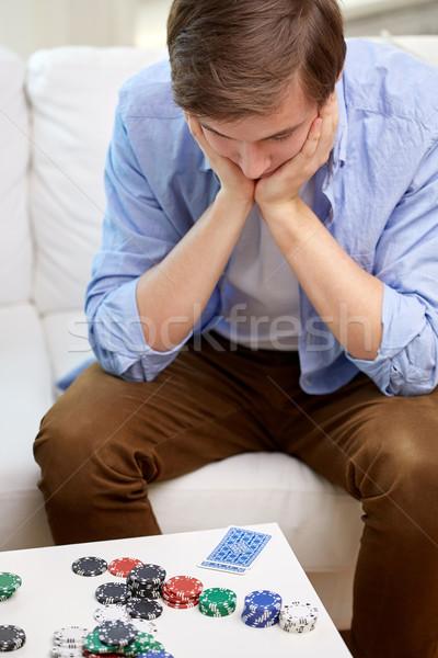Férfi kártyapakli sültkrumpli otthon játék hazárdjáték Stock fotó © dolgachov