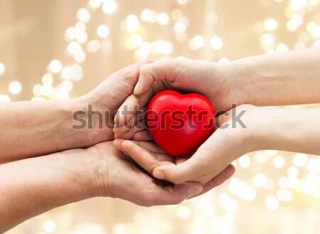 Homme gay couple mains rouge Photo stock © dolgachov