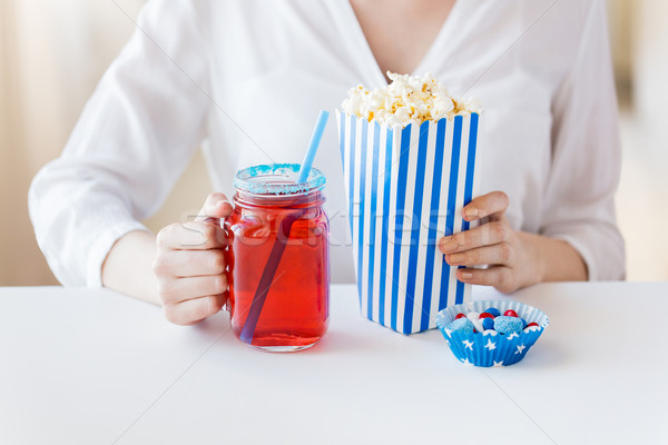woman with popcorn and drink in glass mason jar Stock photo © dolgachov