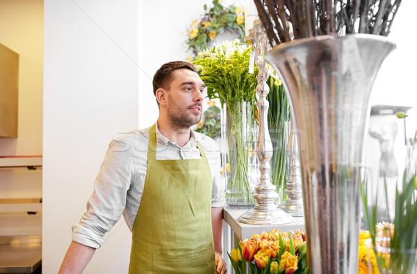 florist man or seller at flower shop Stock photo © dolgachov