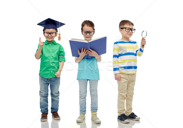 дети очки книга объектив бакалавр Hat Сток-фото © dolgachov