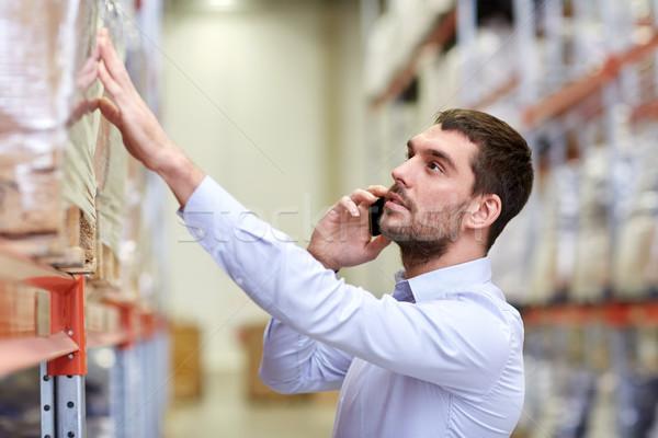 серьезный человека призыв смартфон склад оптовая торговля Сток-фото © dolgachov