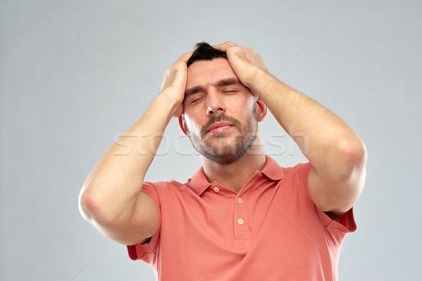 Ongelukkig man lijden hoofd pijn mensen Stockfoto © dolgachov