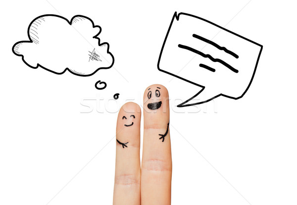 close up of two fingers with communication clouds Stock photo © dolgachov