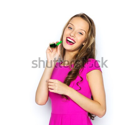 happy young woman or teen girl with party horn Stock photo © dolgachov