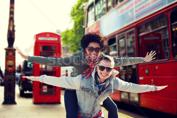 happy teenage couple having fun in london city Stock photo © dolgachov