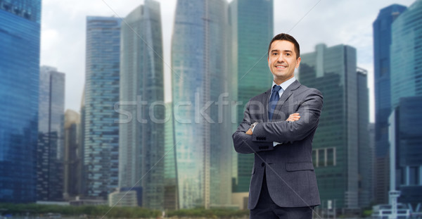 happy smiling businessman over singapore city  Stock photo © dolgachov