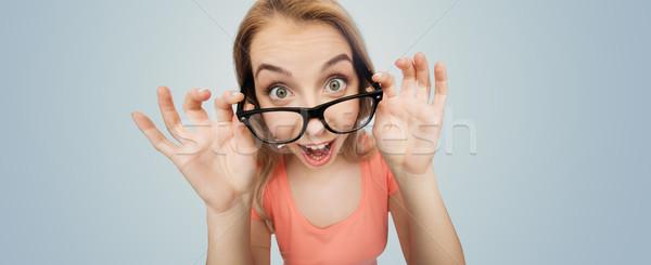 Gelukkig jonge vrouw tienermeisje bril visie onderwijs Stockfoto © dolgachov