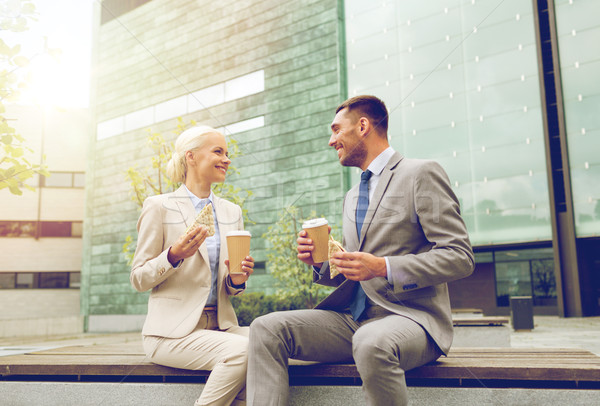 smiling businessmen with paper cups outdoors Stock photo © dolgachov