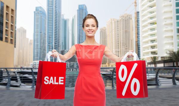 Gelukkig vrouw Dubai stad verkoop Stockfoto © dolgachov