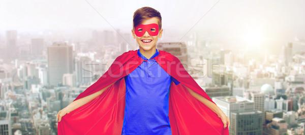 Erkek kırmızı süper kahraman maske şehir karnaval Stok fotoğraf © dolgachov