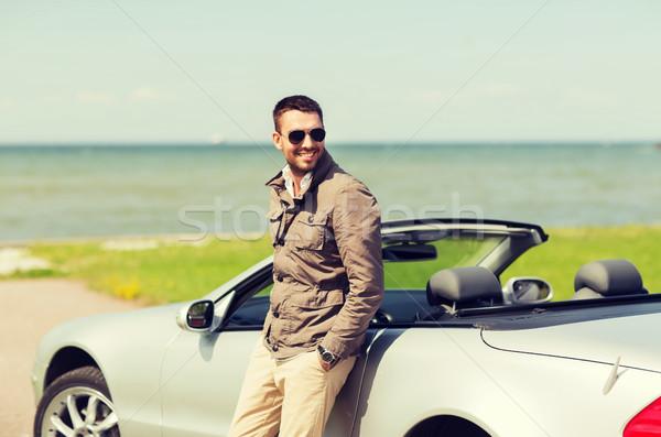 Felice uomo cabriolet auto esterna auto Foto d'archivio © dolgachov
