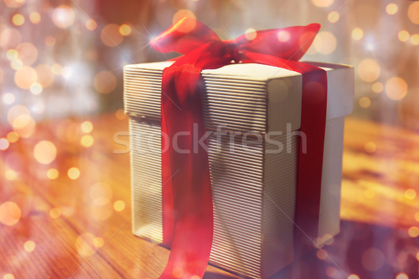 close up of christmas gift box on wooden table Stock photo © dolgachov