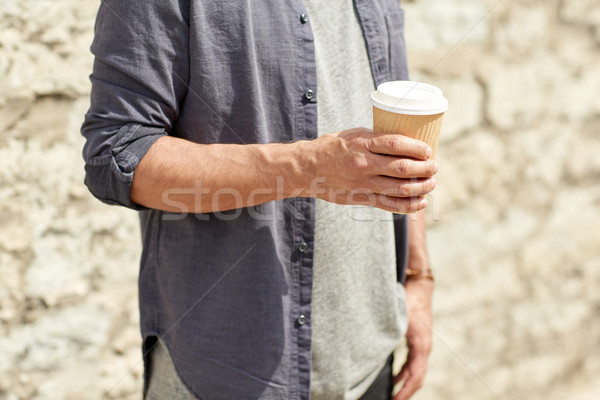 close up of man with paper coffee cup on street Stock photo © dolgachov
