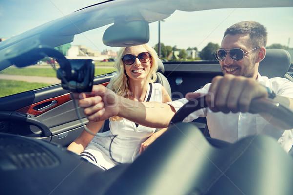 счастливым пару GPS кабриолет автомобилей дороги Сток-фото © dolgachov