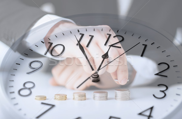 clock over businessman counting euro coins Stock photo © dolgachov