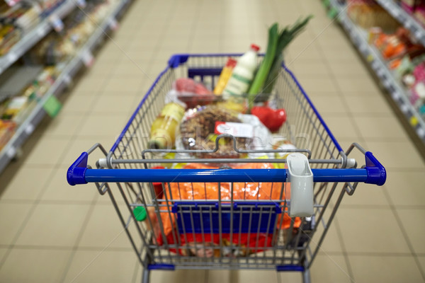 food in shopping cart or trolley at supermarket Stock photo © dolgachov