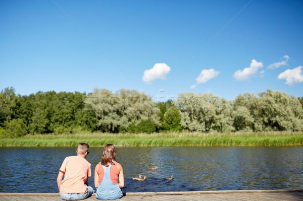 Coppia fiume guardando nuoto amore Foto d'archivio © dolgachov