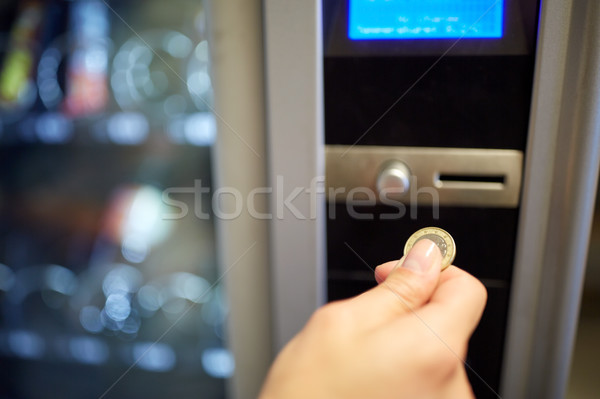 hand inserting euro coin to vending machine slot Stock photo © dolgachov