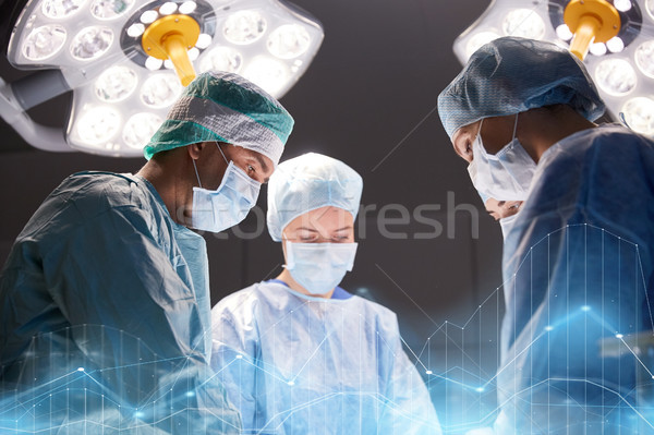 Stock photo: group of surgeons in operating room at hospital