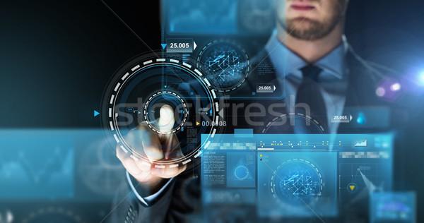 Empresario tocar virtual Screen proyección gente de negocios Foto stock © dolgachov