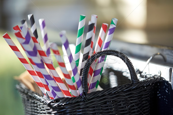 disposable straws in whickered basket outdoors Stock photo © dolgachov