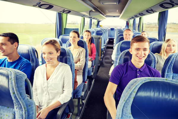 group of happy passengers in travel bus Stock photo © dolgachov