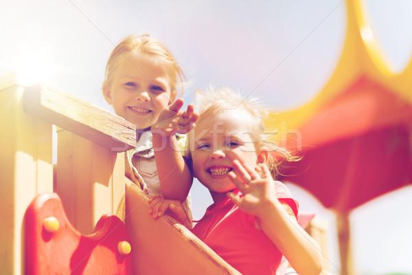 Szczęśliwy dziewcząt ręce dzieci boisko Zdjęcia stock © dolgachov