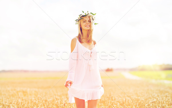 happy young woman in flower wreath on cereal field Stock photo © dolgachov