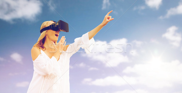 amazed woman in virtual reality headset  Stock photo © dolgachov