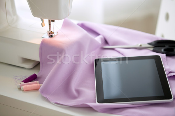 sewing machine, tablet pc, fabric and threads Stock photo © dolgachov