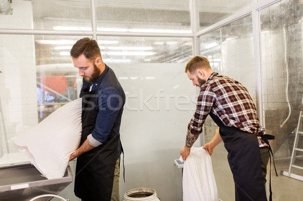 men with malt bags and mill at craft beer brewery Stock photo © dolgachov