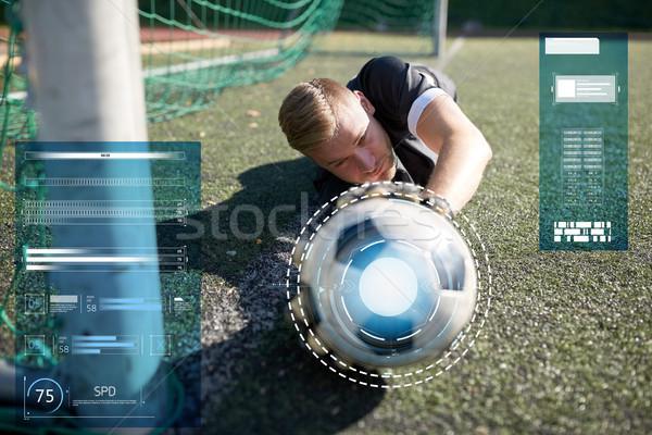 goalkeeper with ball at football goal on field Stock photo © dolgachov