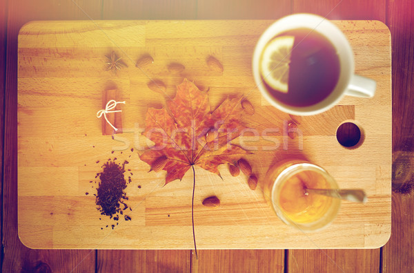 Csésze citrom tea méz fa deszka ősz Stock fotó © dolgachov